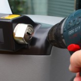 To finish securing the lock to the door handle, drill � 2mm and insert  the screw. (Heosafe 12656_7)