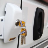 Note that the shape of the main body provides a slope which faces towards the sliding door when the lock is in the opening position: this allows for the initially smaller clearance when the door first begins to slide open. (heosafe_1760_fitted_side)